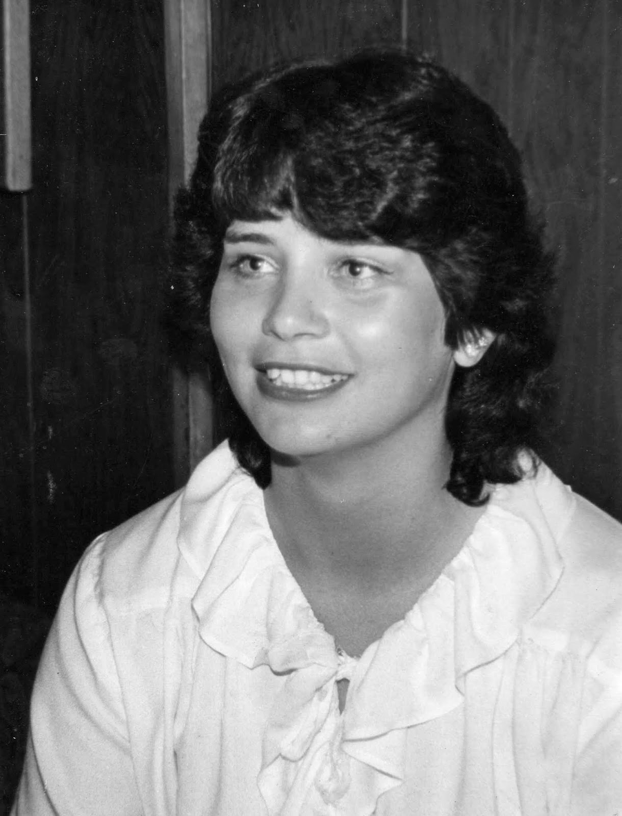 Teenage girl in the 1970s with medium length dark wavy hair