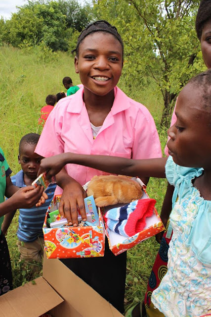 Girl with her OCC shoebox.
