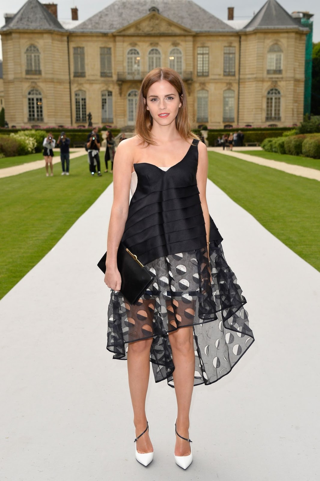 6c14b635 Emma Watson in an embroidered silk dress at the Fall 2014 Dior Couture Show  in Paris