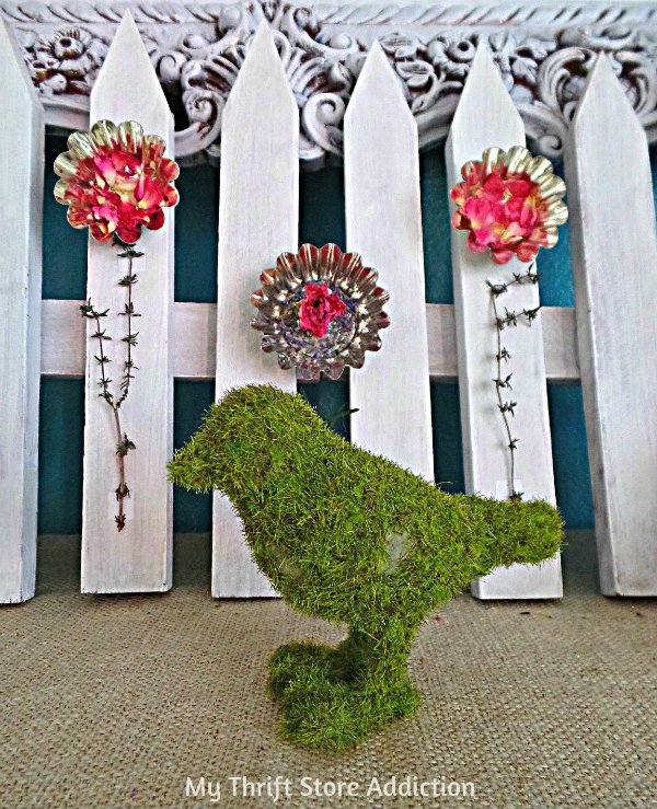 Tart Tin and Herb Flower Garden Mantel mythriftstoreaddiction.blogspot.com Repurposed flowers created from tart tins paired with herbs against a picket fence for a natural spring mantel