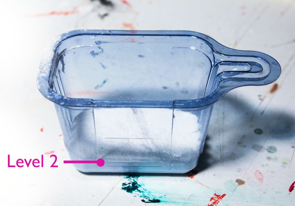 Use laundry detergent to clean paintbrushes, fill to the scooper to line 2