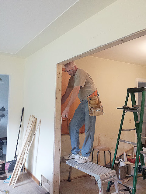 Jim measuring for drywall