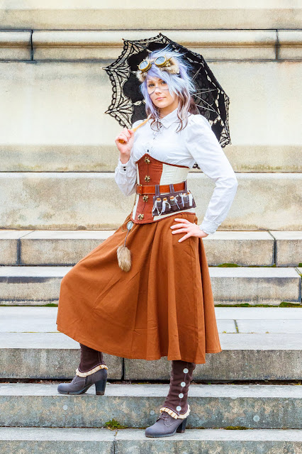 Steampunk clothing for women. This costume includes blouse, skirt, corset, boots, apothecary holster, goggles and parasol