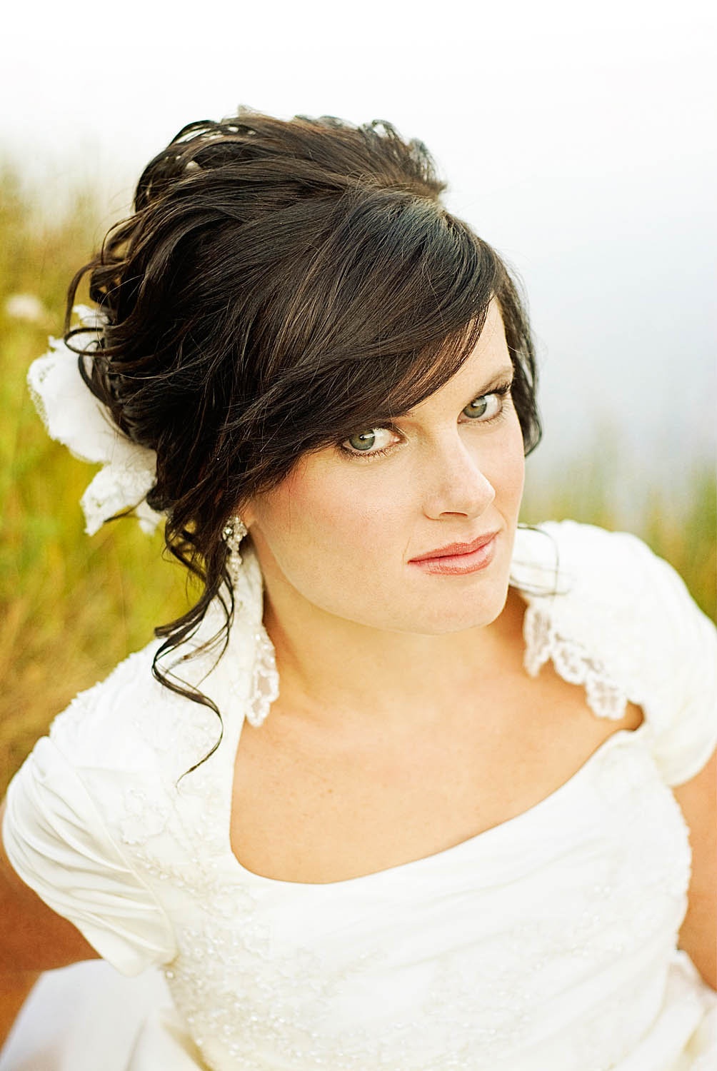 Hair and Makeup by Steph How to Incorporate Your Bangs into Your Wedding Hairstyle