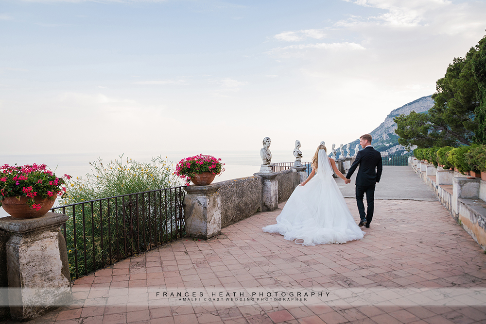 Bride and groom walking on infinity terrace at Villa Cimbrone
