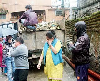 Workers clean garbage in Darjeeling municipality