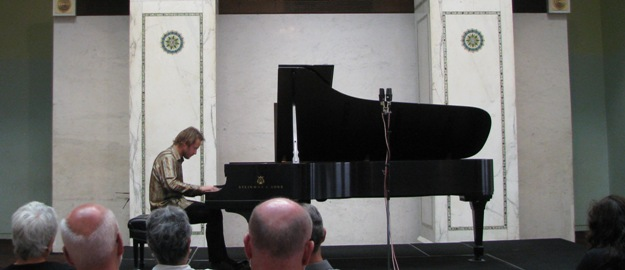Pianist Samuel Deason performing during a Dame Myra Hess Memorial Concert in Preston Bradley Hall at the Chicago Cultural Center in Chicago, Illinois