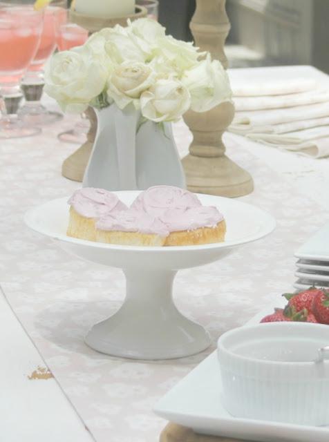 White Belgian stone pedestal with pink cupcakes - Hello Lovely Studio