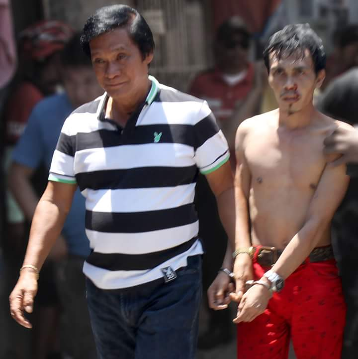Look: Pasig Brgy. Captain R. Asilo leads arresting Ansawe Tagalangit (suspect)