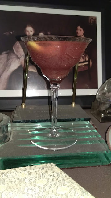 Bloody Carrie Martini with gin & raspberry syrup.