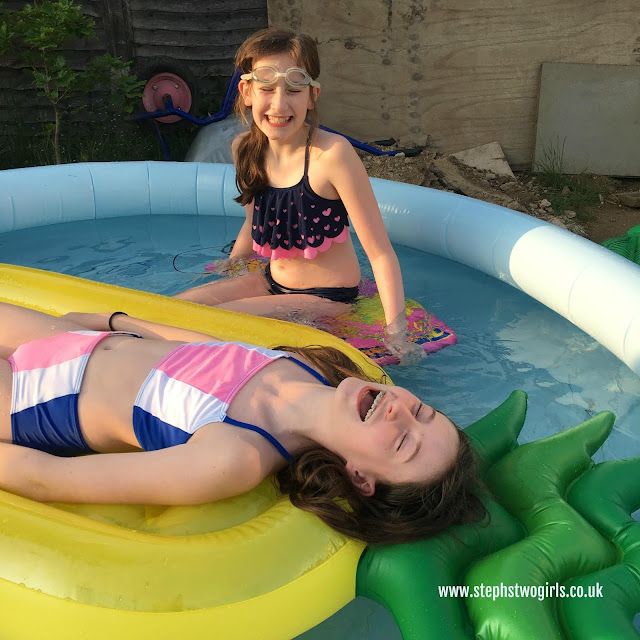 Stephs Two girls laughing in pool