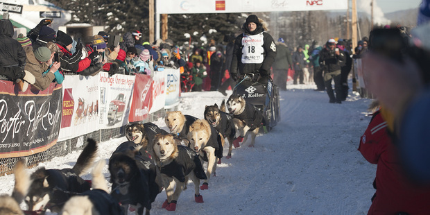 Father, son battle for lead in Iditarod race across Alaska