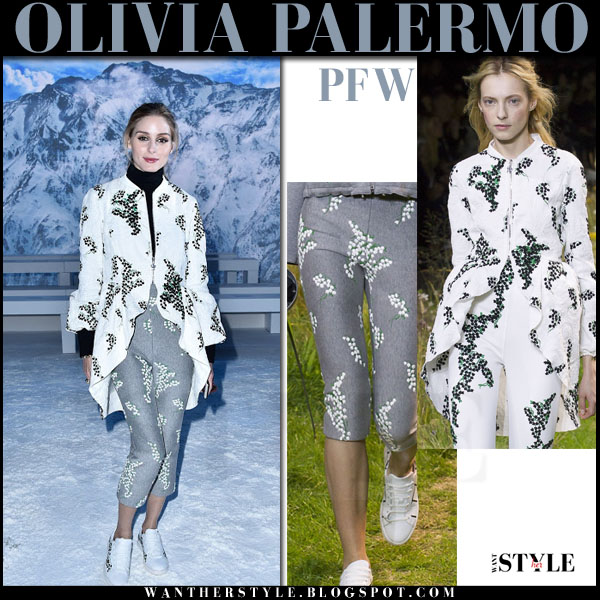 Olivia Palermo in white embroidered hi low moncler gamme rouge jacket and grey embroidered cropped moncler gamme rouge pants what she wore pfw front row