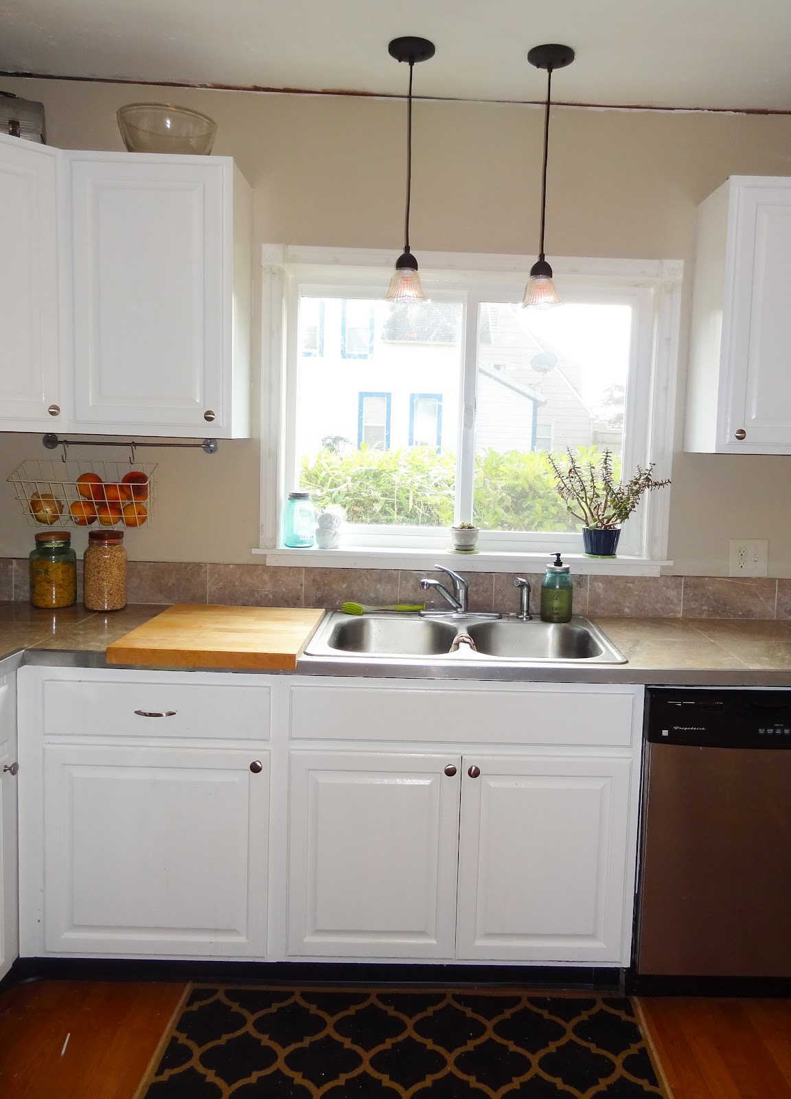 kitchen sink pendant light how much does a remodel cost diy update your lighting on the cheap revamp
