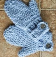 http://www.craftsy.com/pattern/crocheting/accessory/free-darlas-easy-on-mitts/42158