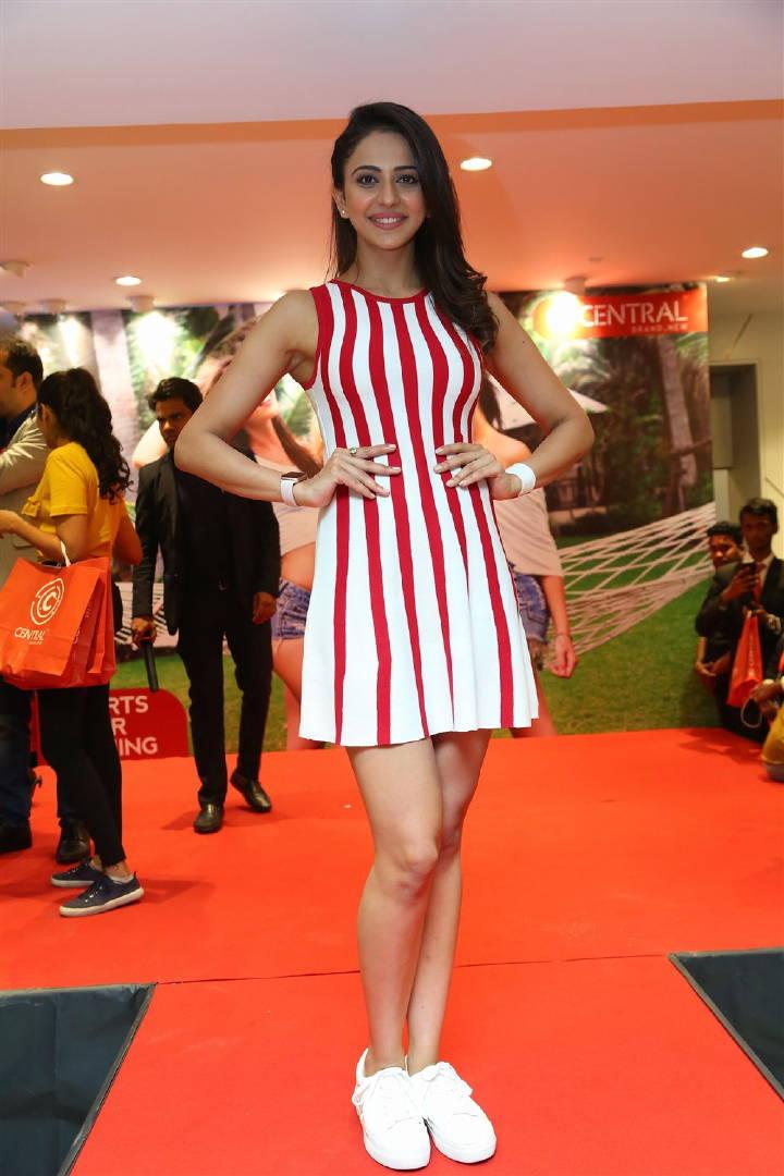 Rakul            Preet Singh Long Legs Show At Launches Strip To Short            Campaign