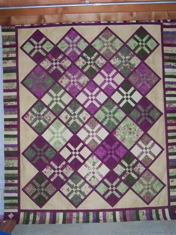 Batiki Argyle Quilt Quilted by Quilter 65 from Quilting Board, The Pattern by Debbie Bailey of And Sew 4th