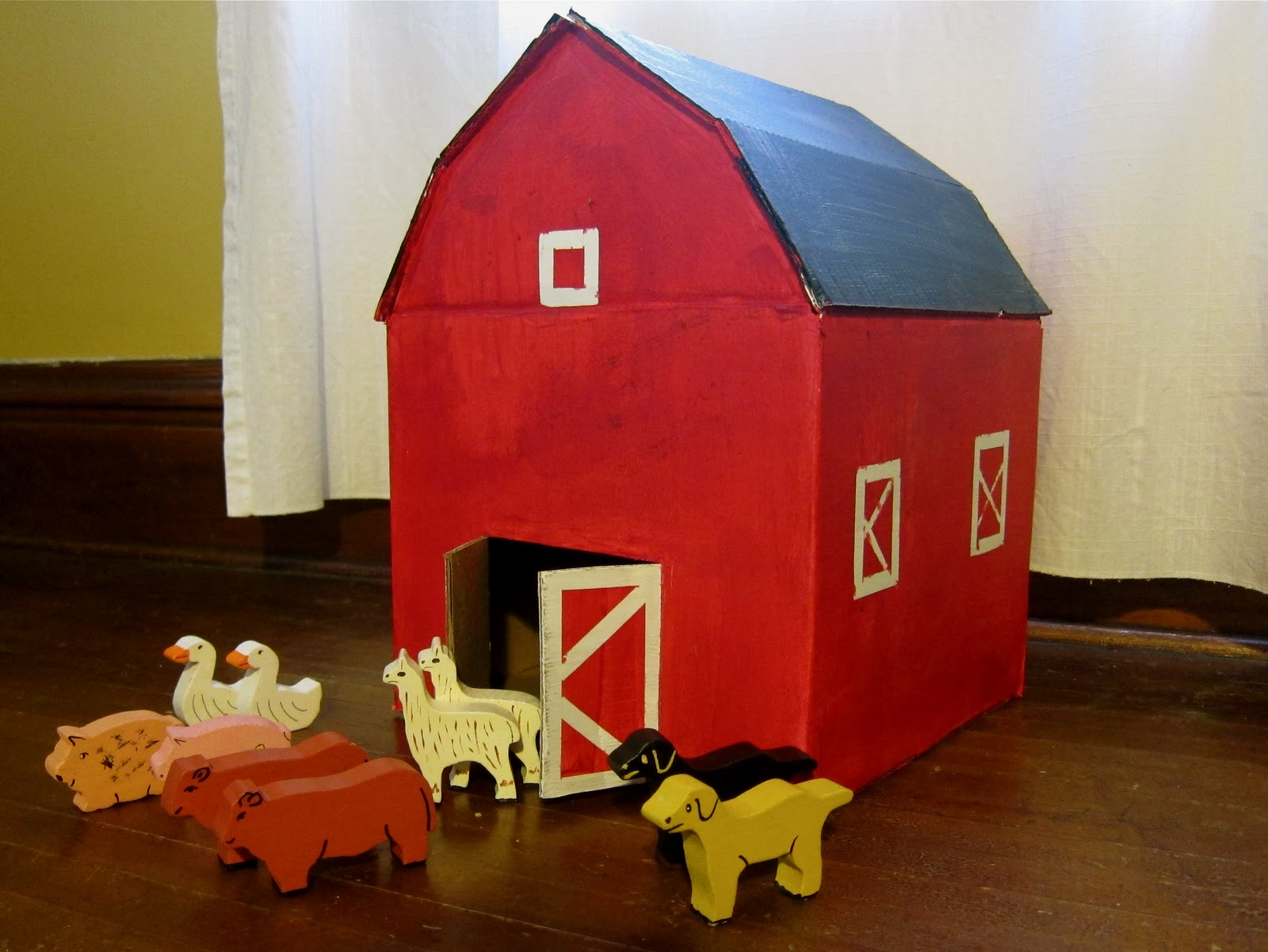 A Little Red Cardboard Barn