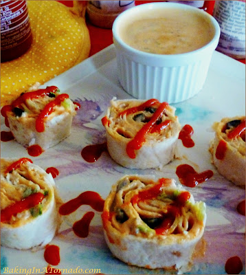 Spicy Chicken Roll Ups, little sandwich bites with a kick. Serve as an appetizer or for lunch | Recipe developed by www.BakingInATornado.com | #recipe