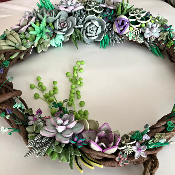 quilled succulent wreath on table