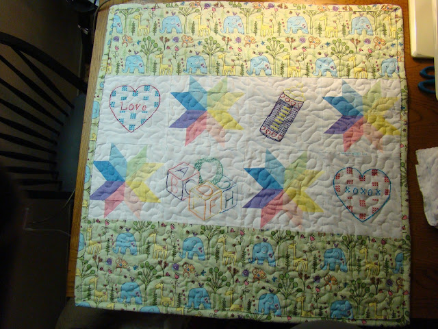 Starflower and embroidery blocks pastel baby quilt