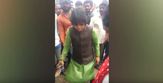 Bhumata Brigade's Trupti Desai has been caught on camera thrashing a youth with her slipper.   The incident occurred at Shikrapur village near Pune. The youth allegedly fell in love with a woman, developed physical intimacy, got her pregnant and then refused to marry her.   Trupti Desai is seen beating him up with the help of an associate as a crowd watches them silently.