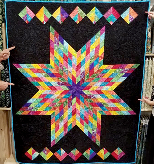 Rainbow Lone Star Quilt Free Pattern designed by Donna Jordan for Jordan Fabrics