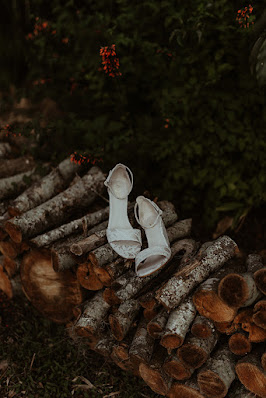 wedding shoes on pile of wood