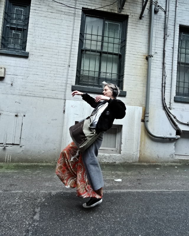Mel Kobayashi of Bag and a Beret listening to tunes in a Vancouver alley. Check the huge vintage palazzo pants.