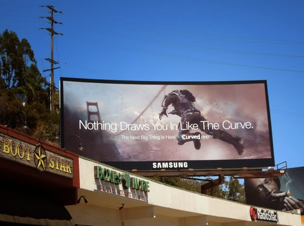 Nothing draws you in like The Curve Samsung Curved UHD TV billboard