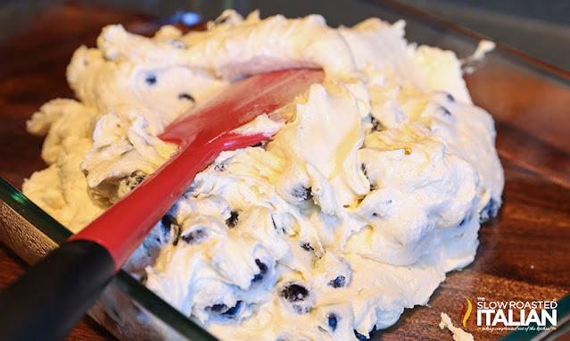 spreading cake batter into a baking pan