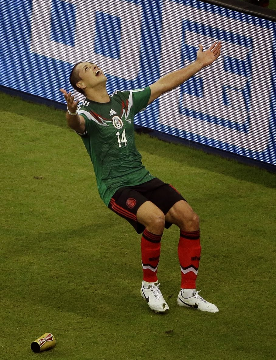 Mexico's Javier Hernandez (14) celebrates scoring his side's 3rd goal during the group A World Cup soccer match between Croatia and Mexico at the Arena Pernambuco in Recife, Brazil, Monday, June 23, 2014.