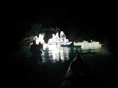 Nigel Foster photo, kayaking in sea cave with stalactites
