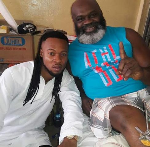 Singer Flavour Visits Actor Harry Anyanwu At The Hospital