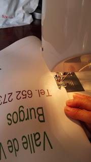 coser cartel publicitario bicicleta