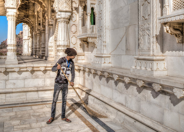 a boy cleaning temple
