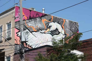 Half Decent Swan artwork on Kingston Road Rooftop