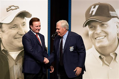 Richard Childress (left) and Rick Hendrick shake hands after receiving their Hall of Fame jackets.