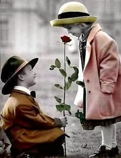 Boy giving rose to girl in lone lovely Picture