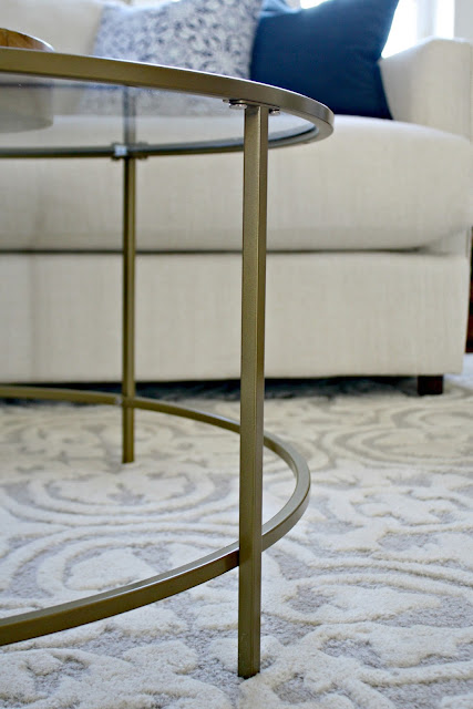 Glass and metal round coffee table