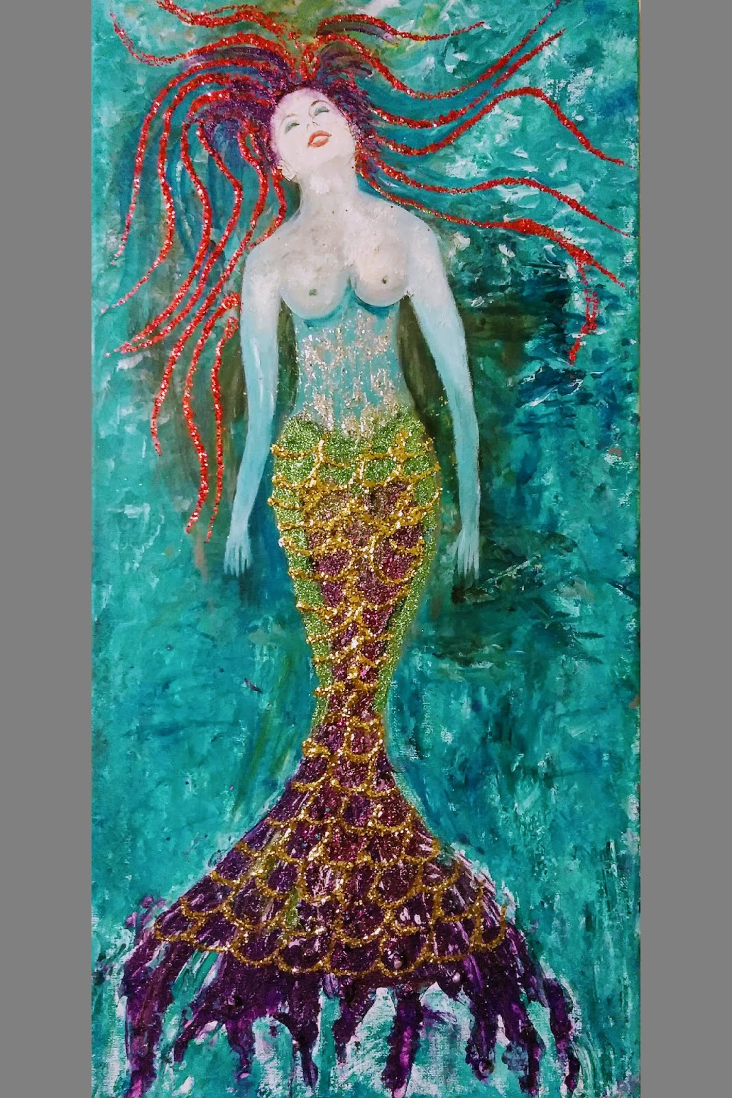 Colorful painting of a beautiful mermaid in the sea: young woman with red hair