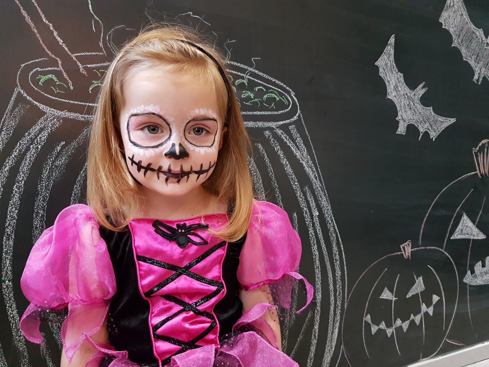 toddler girl with sugarskull make up