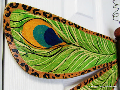 peacock feather design edged in leopard print