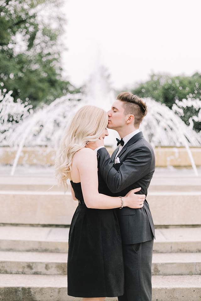 Romantic photoshoot in front of the Winnipeg Legislative building.  Couples outfit idea: classic little black dress and charcoal grey suit.