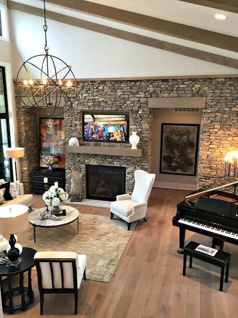 family room with stone walls and wood beams