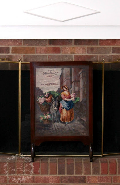 Needlepoint fireplace screen.