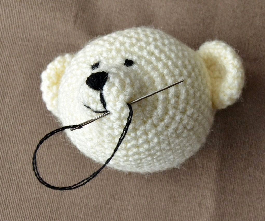 hand embroidery of mouth of crocheted bear