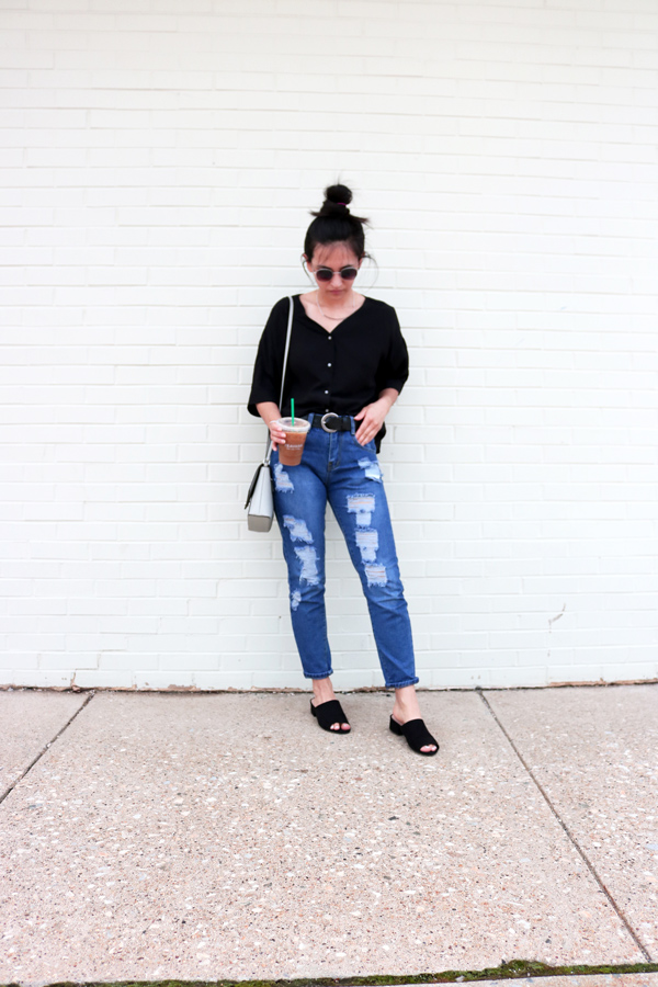 ripped blue jeans, black blouse, black mules