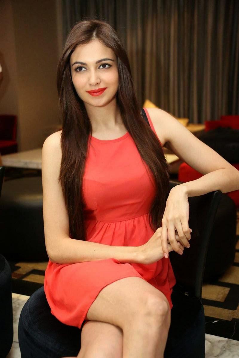 Simran Kaur Mundi Stills, Simran Kaur Mundi Long Legs hot Pics in Red short Dress & Boots