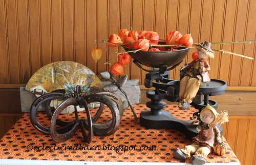 Fall vignette with horse shoe pumpkin